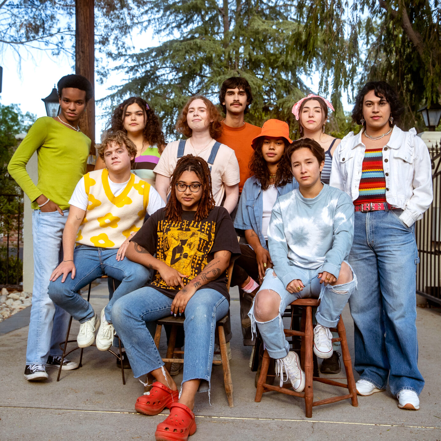 Group of LGBTQ young people standing together and looking into the camera