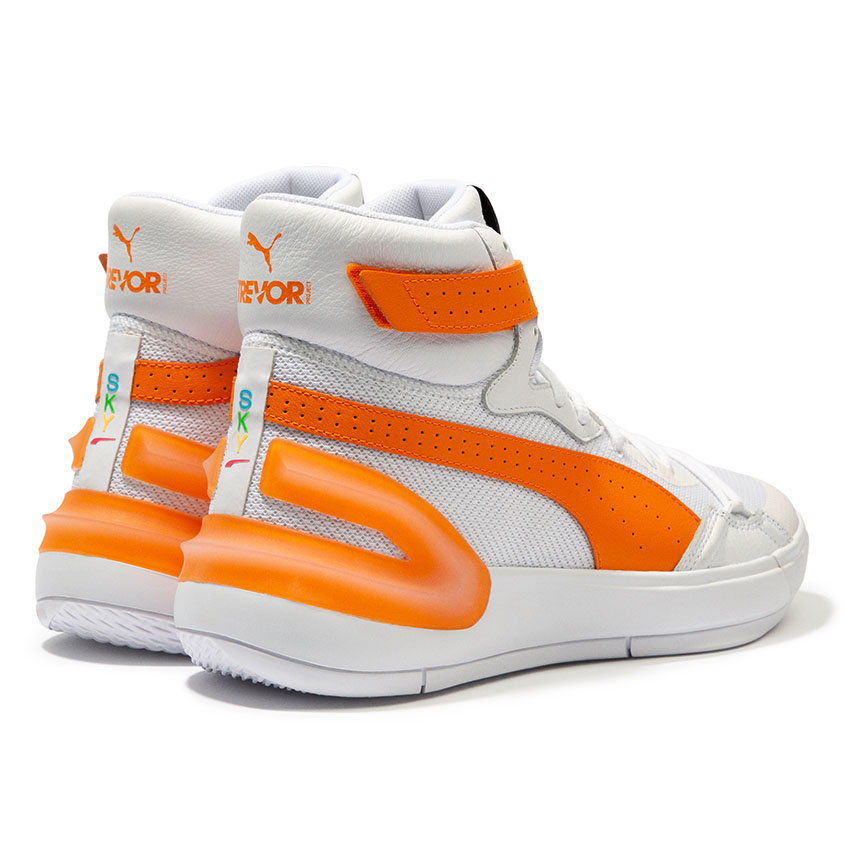A white and orange pair of high-top shoes branded with PUMA and The Trevor Project logos.